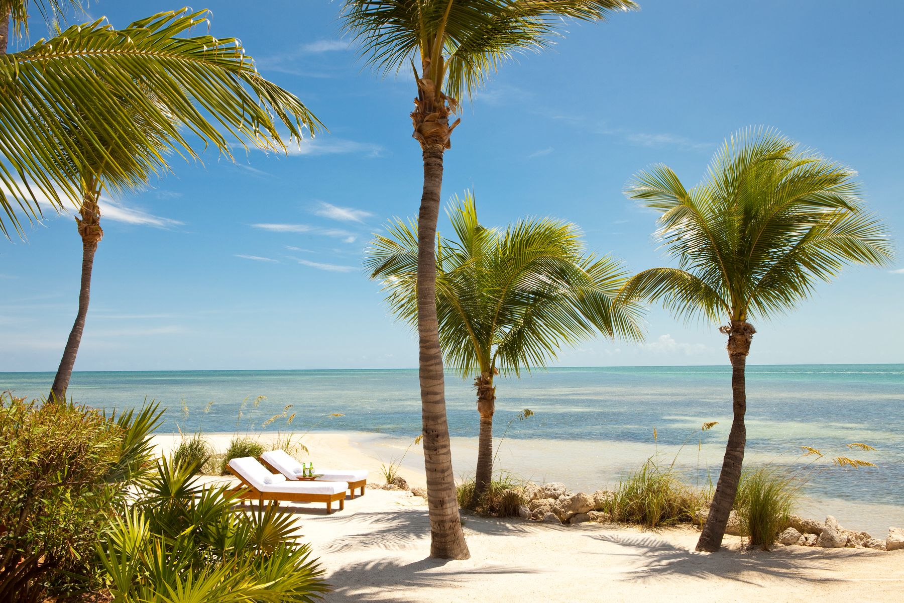 Beachside loungers at the Little Palm Island Resort & Spa