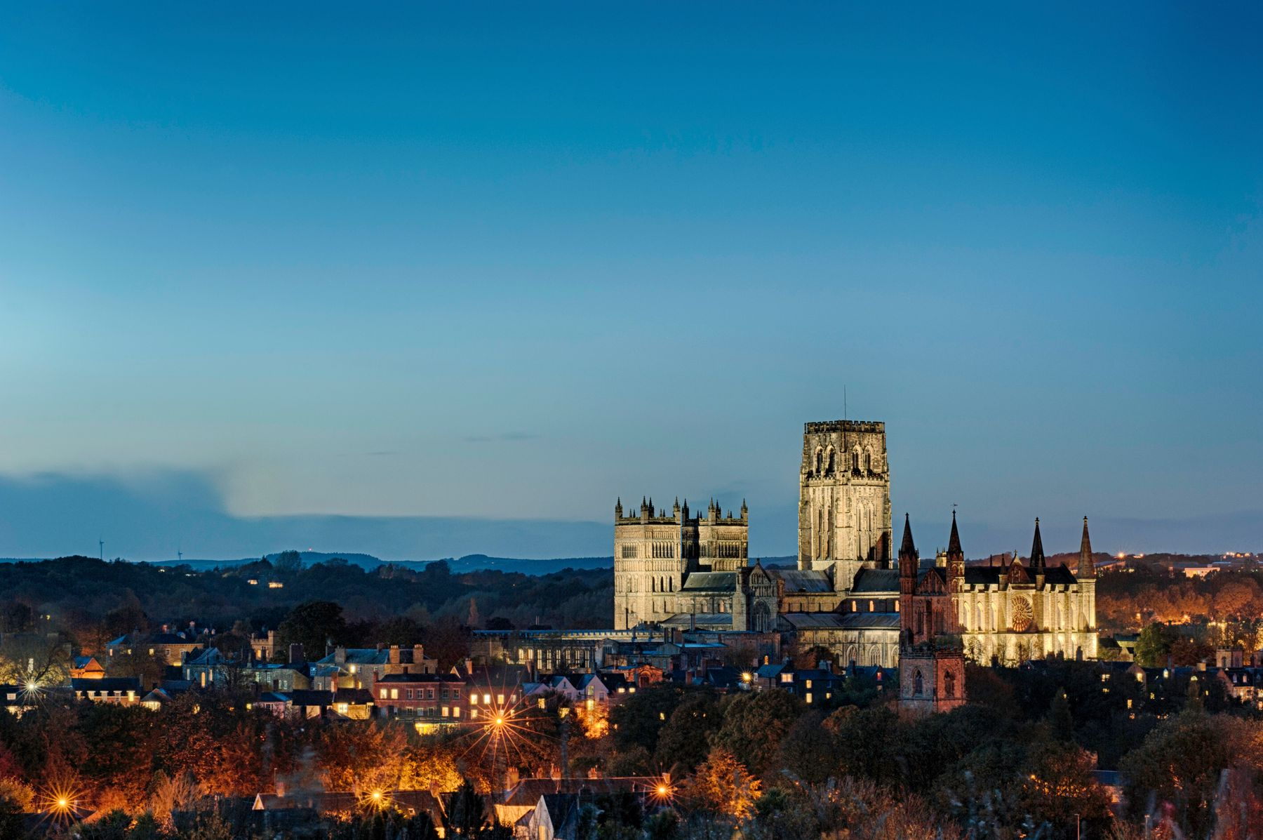 Picture shows the city of Durham at night time, with its cathedral rising above the city skyline.