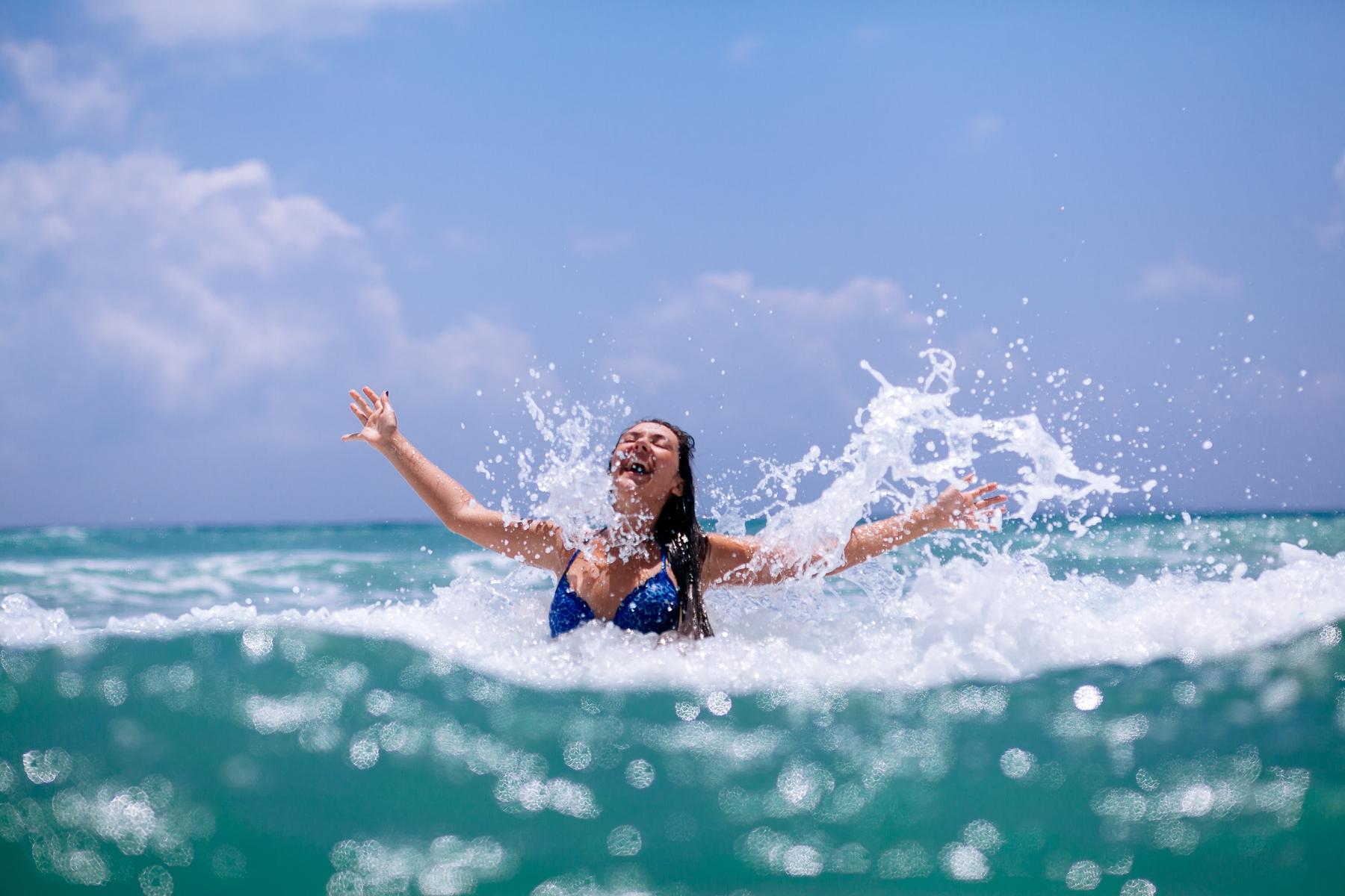 girl splashing in the water