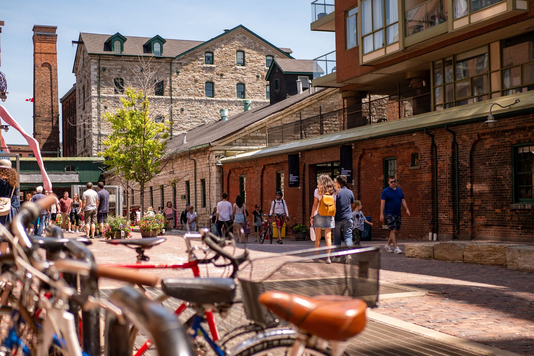 people walking through the Distillery District in Toronto