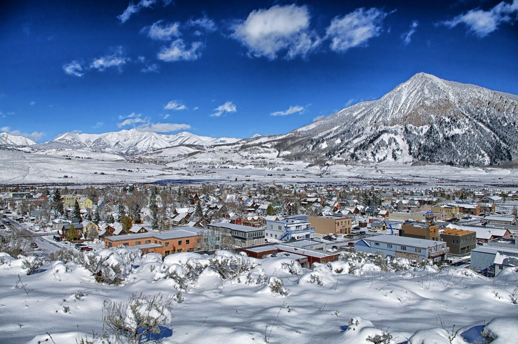 Colorado's Crested Butte town covered in snow with Crested Butte Mountain in the background.