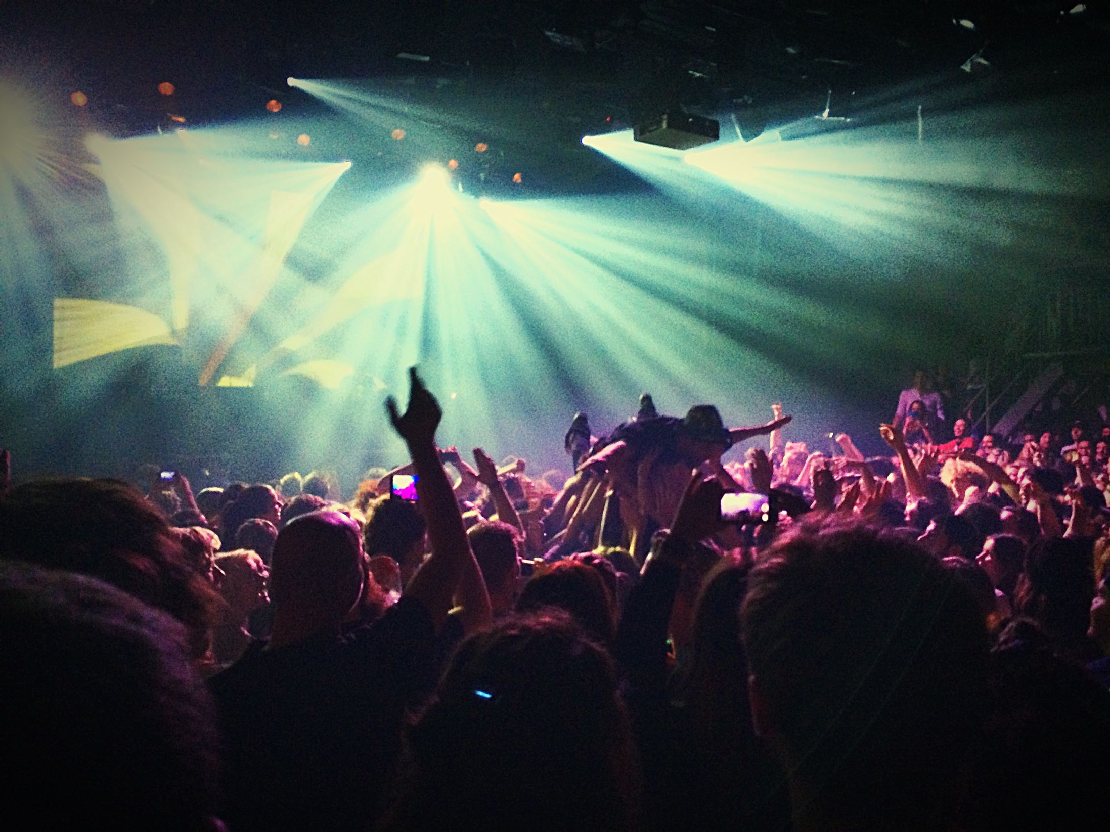 People dancing and crowd surfing in Amsterdam - one of the best party cities in Europe