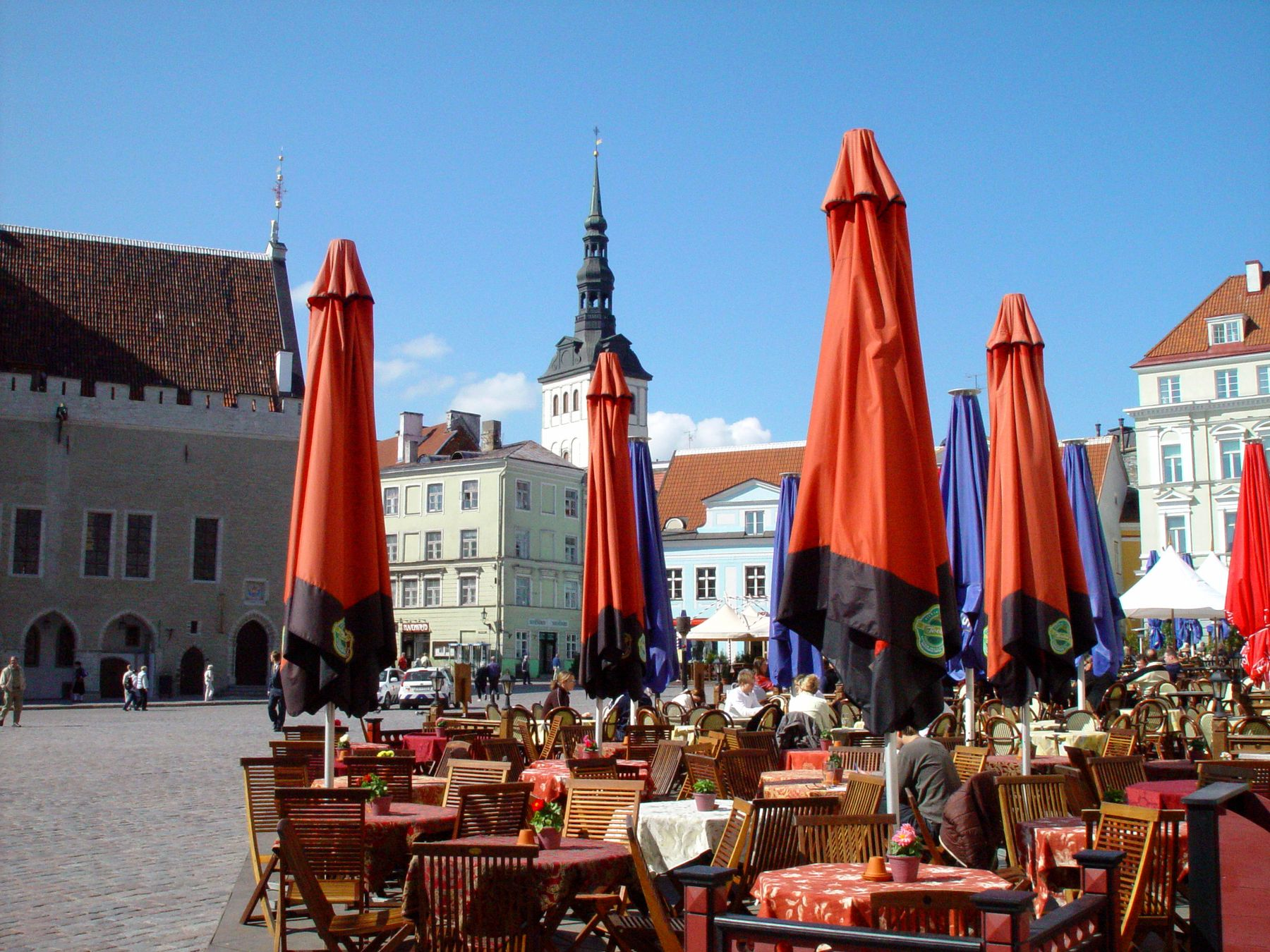 tables, chairs, and umbrellas in an Estonian public square