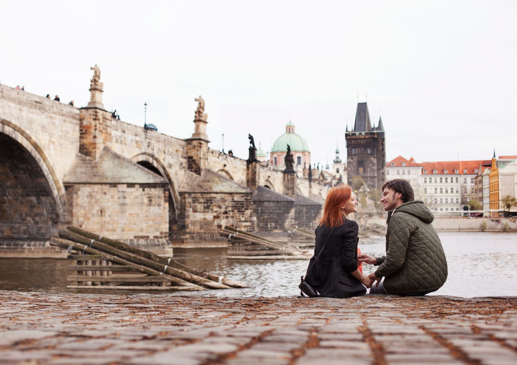 Couple sitting in Prague