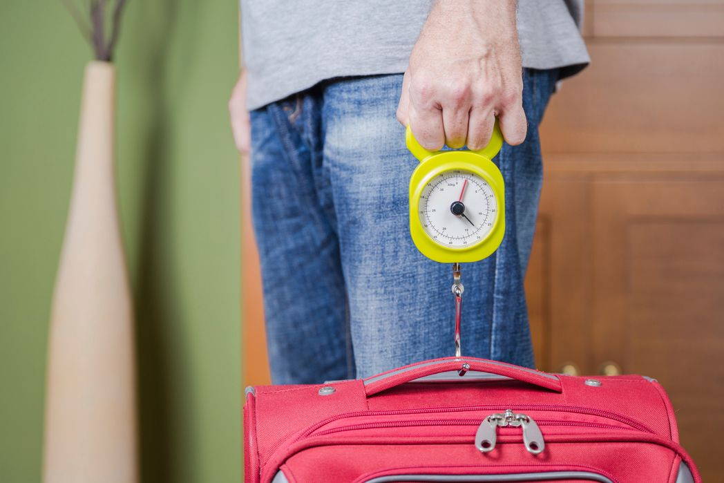 how to avoid extra luggage fees: weigh your luggage