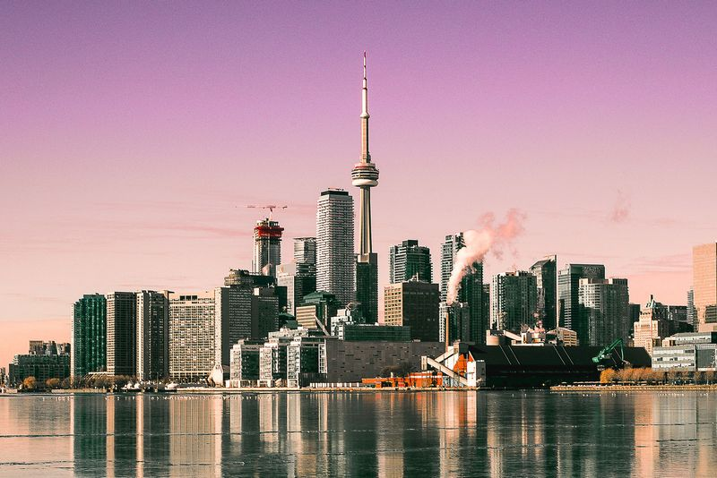 Skyline of Toronto with a view of the CN Tower and a pink sky