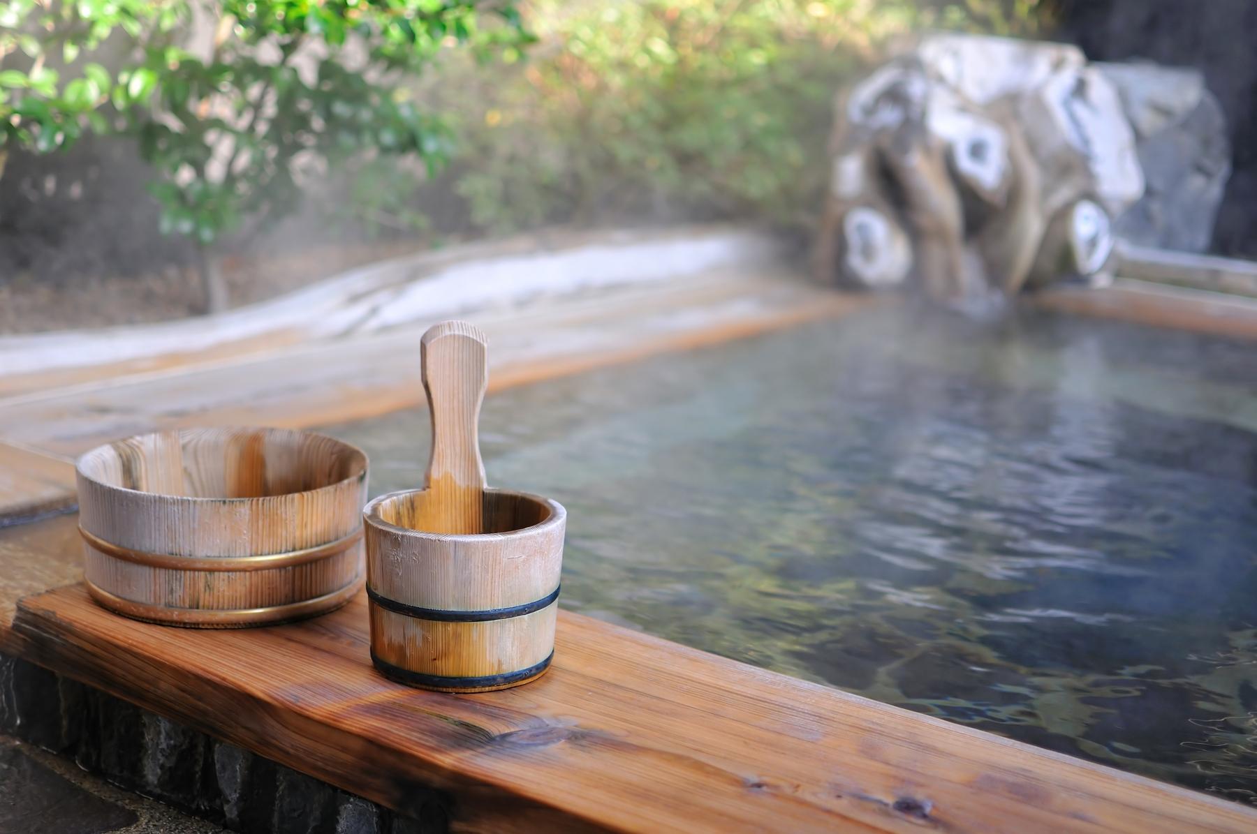 hot water pool and wooden bowls at a ryokan in Japan