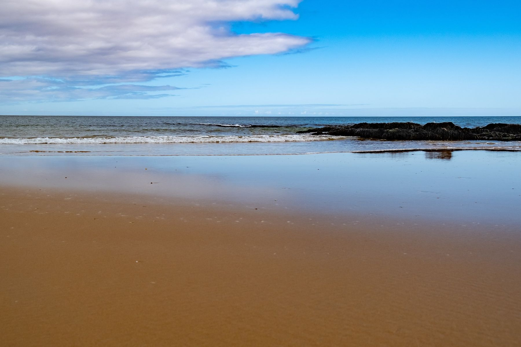 Tranquil Dornoch Beach sits behind the Royal Golf Hotel, one of the best beach hotels in Scotland