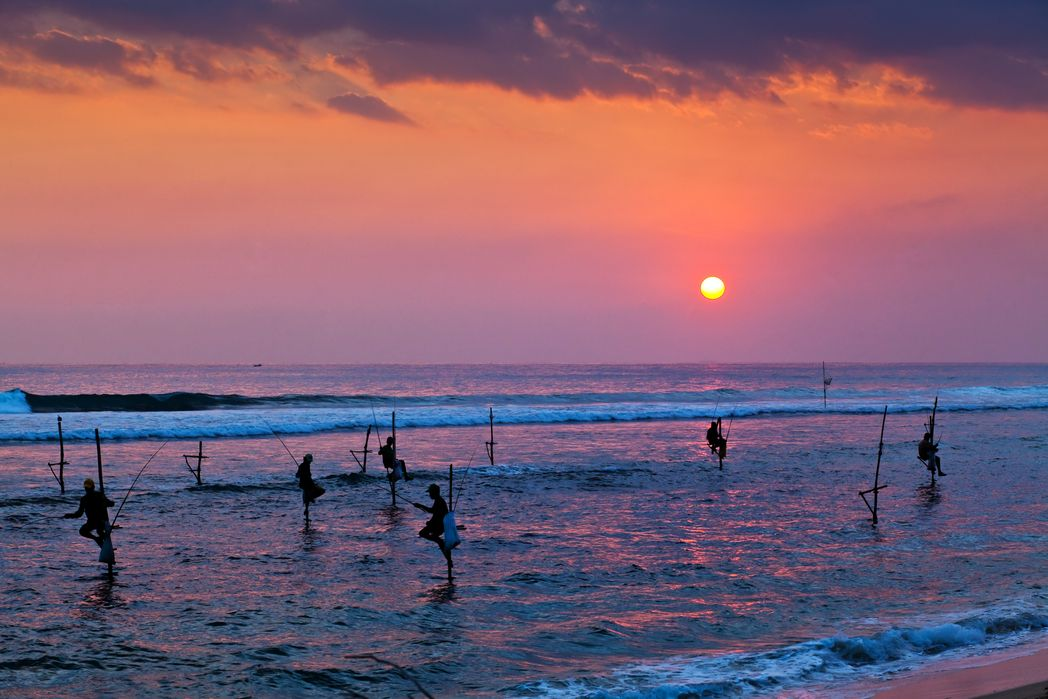 Fishermen in the sea at sunset - When is the Best Time to Visit Sri Lanka in 2020