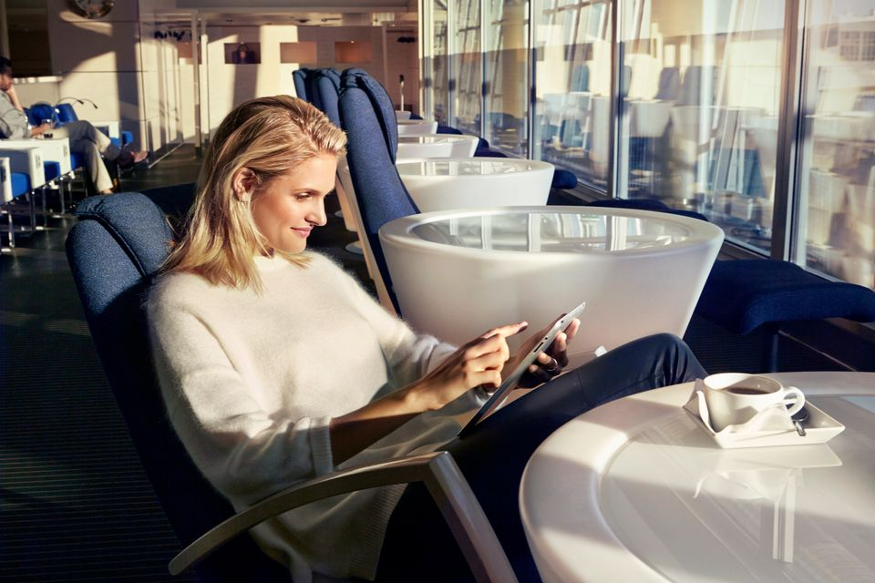 Woman reading at an airport lounge
