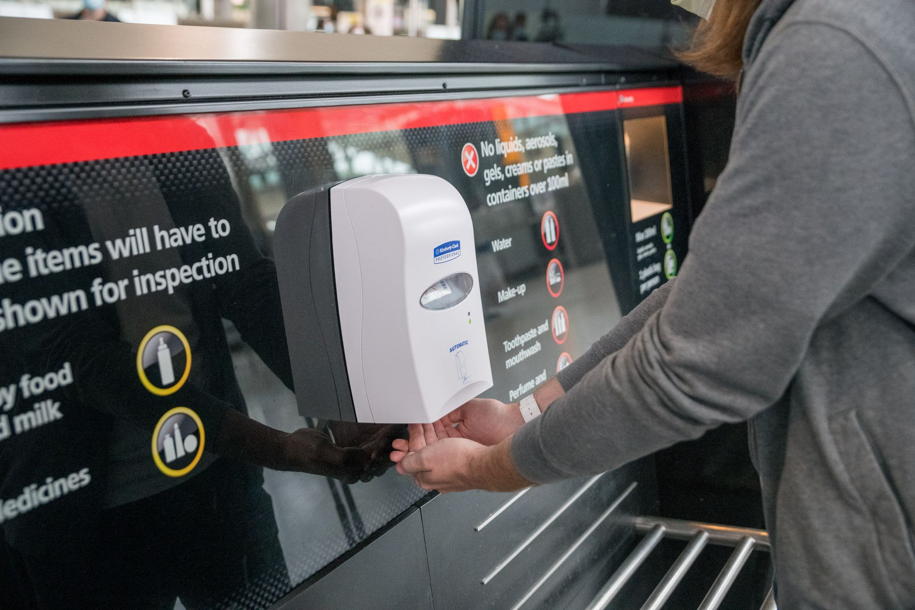 hand sanitizer station in airport