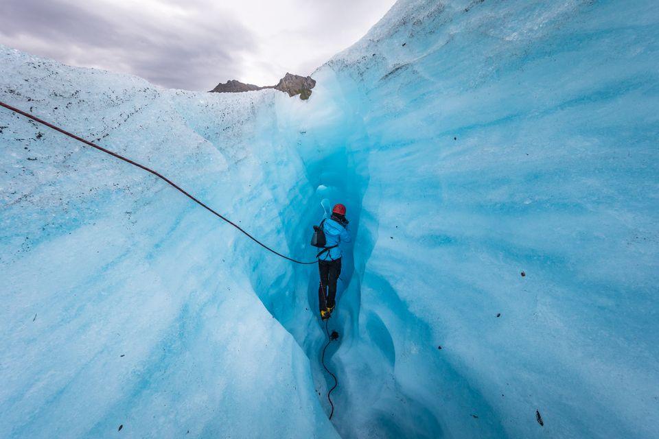 Traveller exploring an iceberg