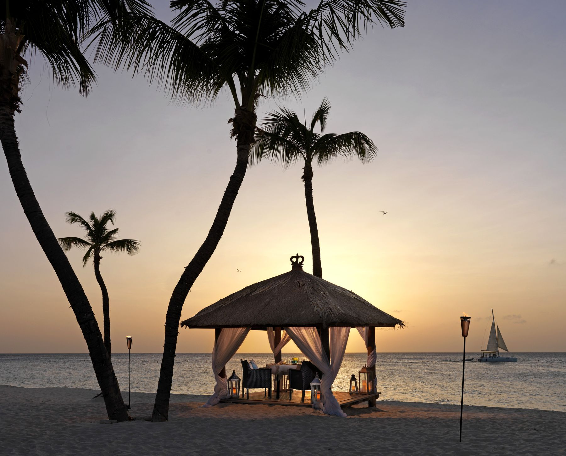 private dining canopy at the beach by sunset