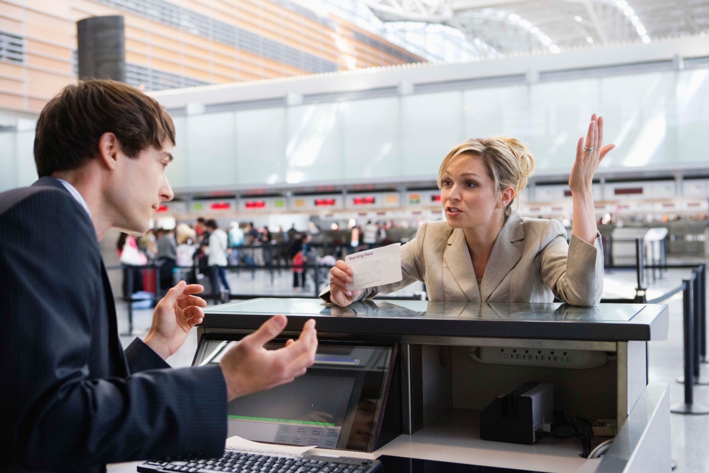 Angry woman at airport check-in