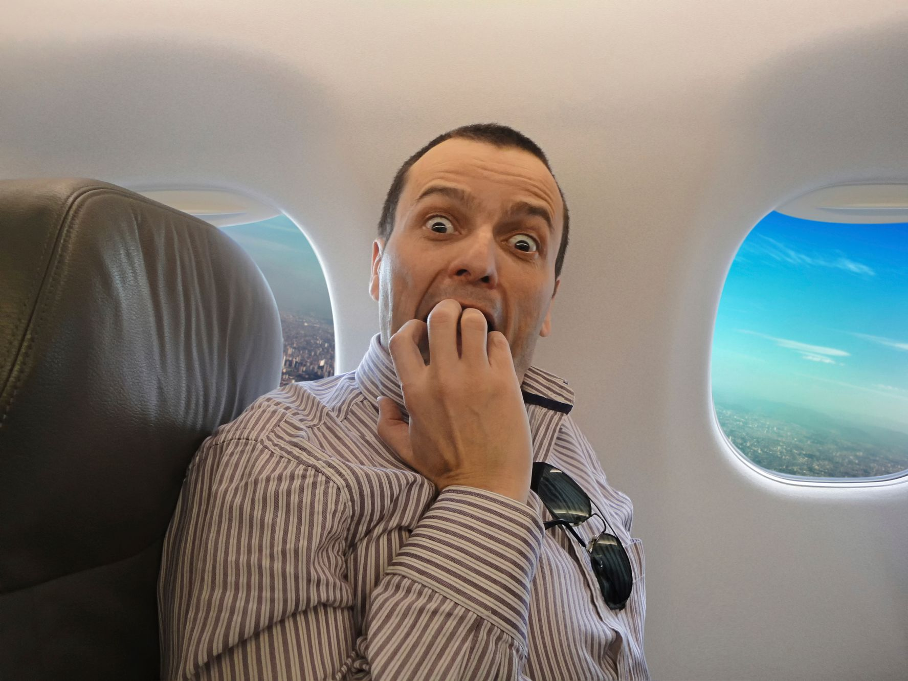 Man scared on a plane