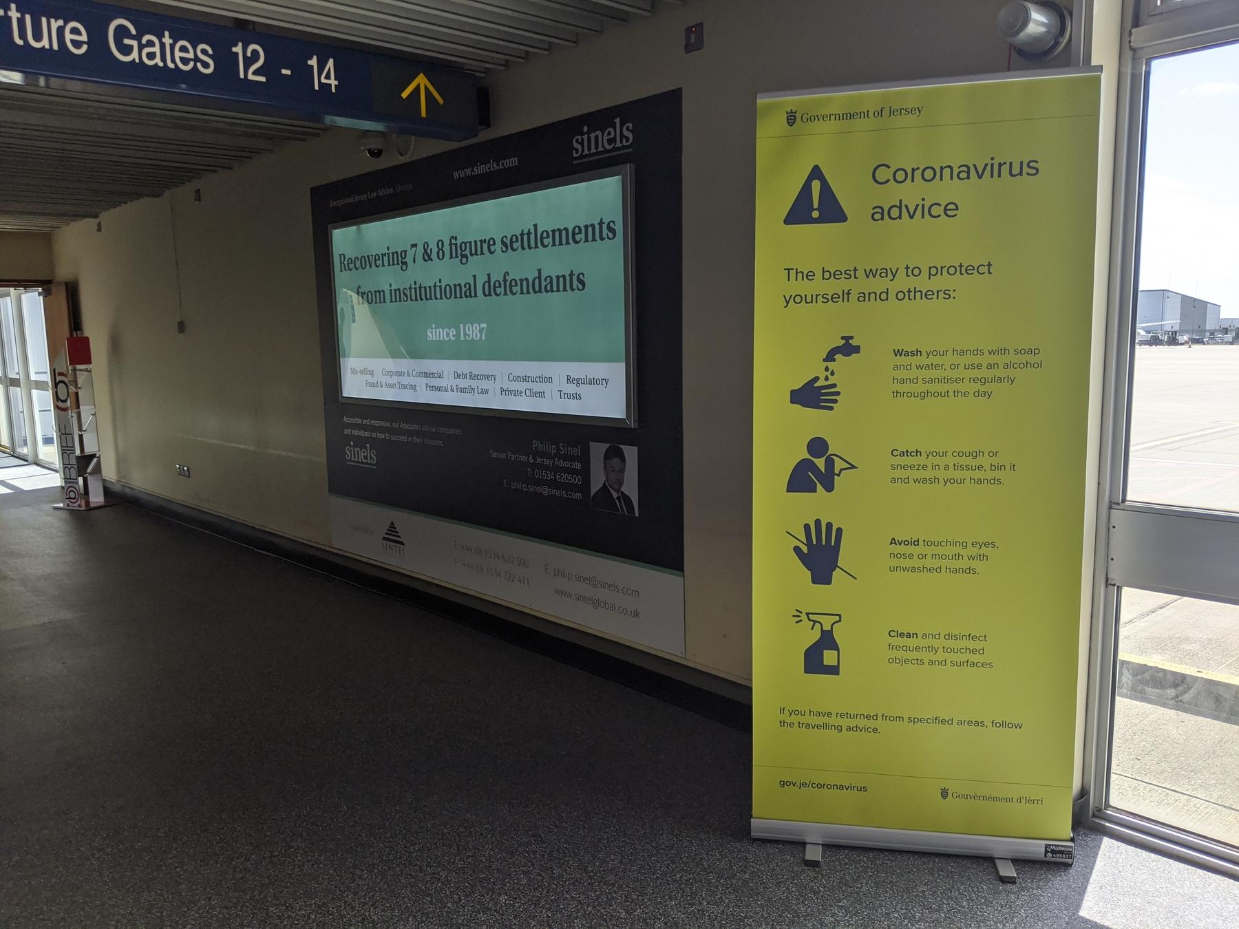 coronavirus advice banner in an airport