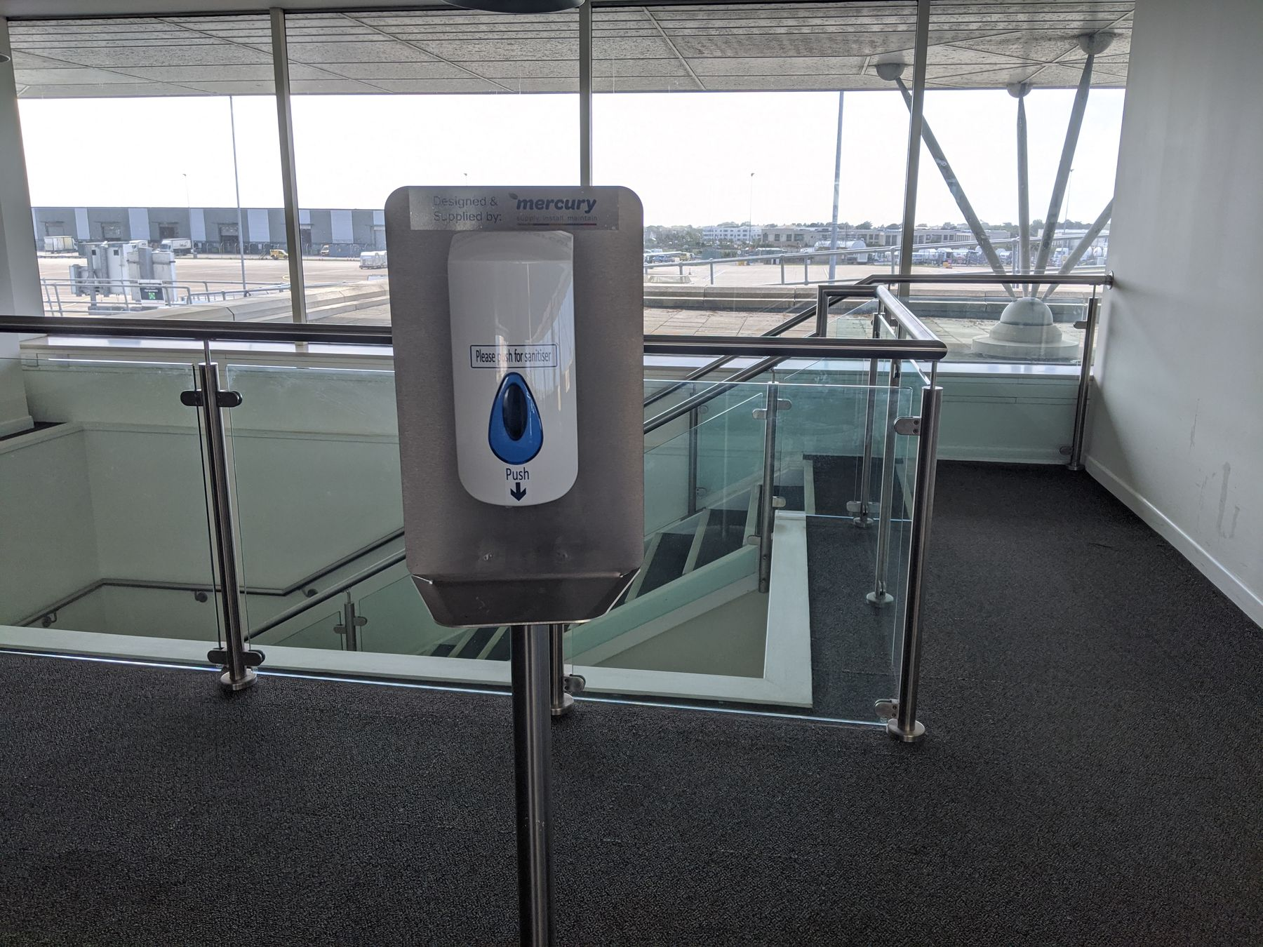 Hand sanitizer station at the airport