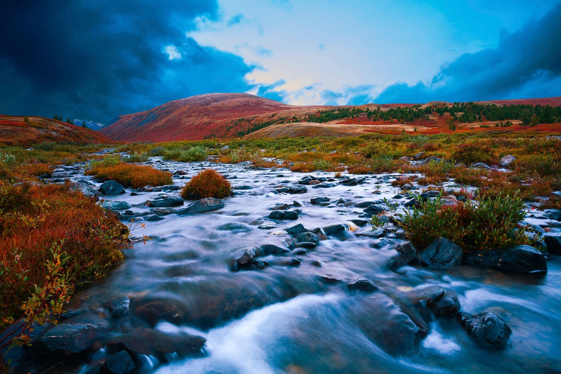 fast flowing water through orange desert landscape