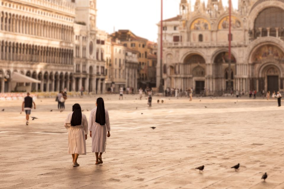 Two nuns walk in St Mark's Square - 8 best things to do in Venice on a budget