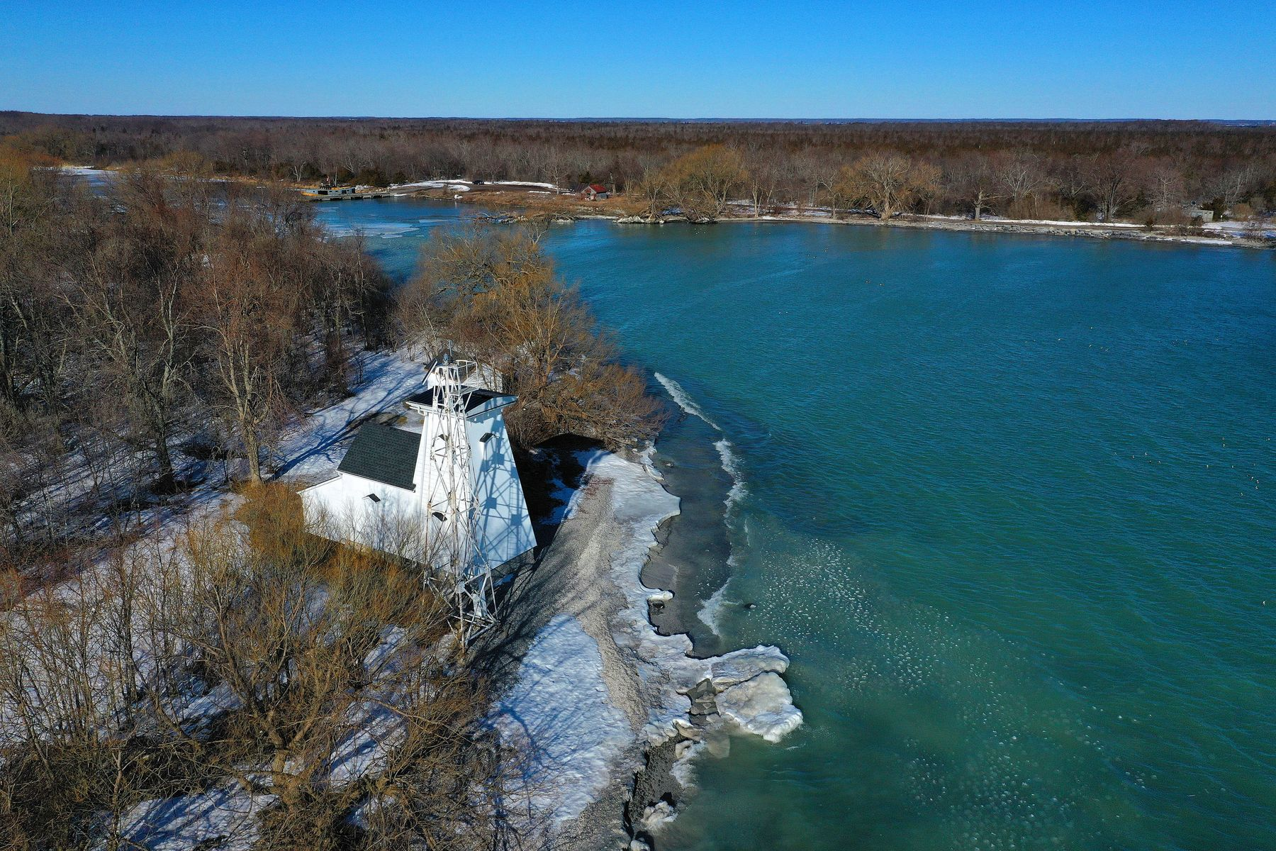 shoreline of Lake Ontario in Prince Edward County with a lighthouse, on a winter's day