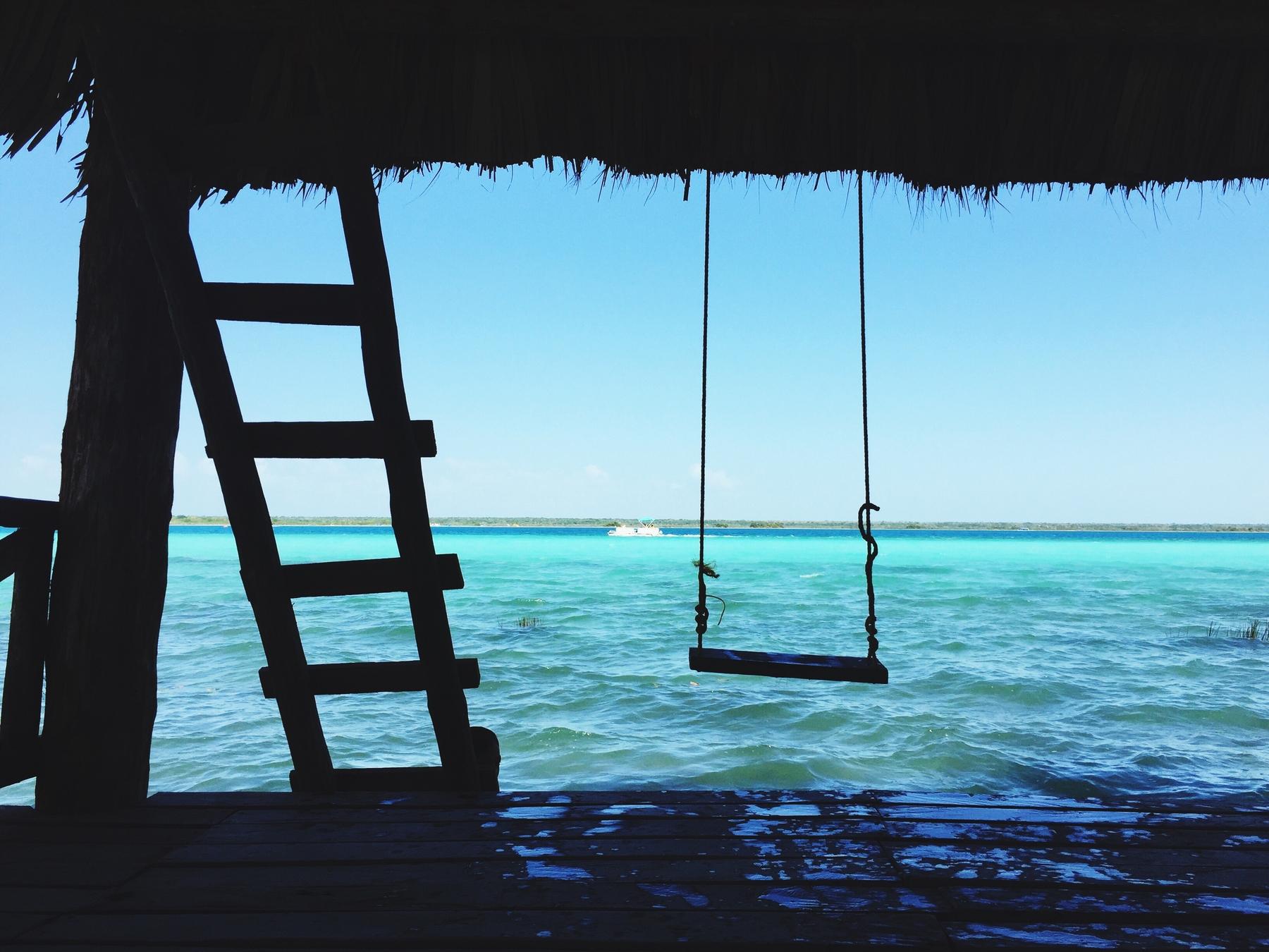 empty swing above water