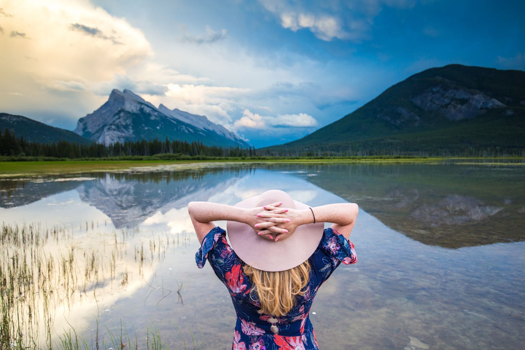 A woman looking out at a landscape in Canada, one of the best places to travel alone.
