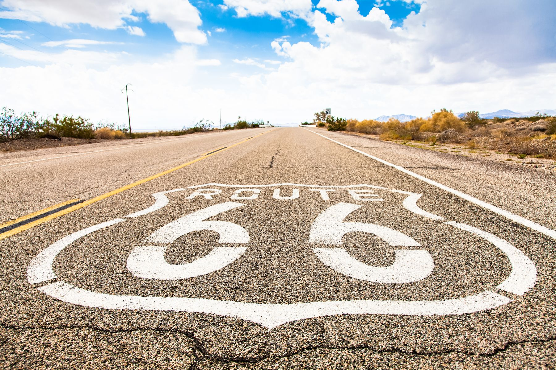 Famous Route 66 landmark on the road in Californian desert - Budget travel tips & deals to help you live the dream