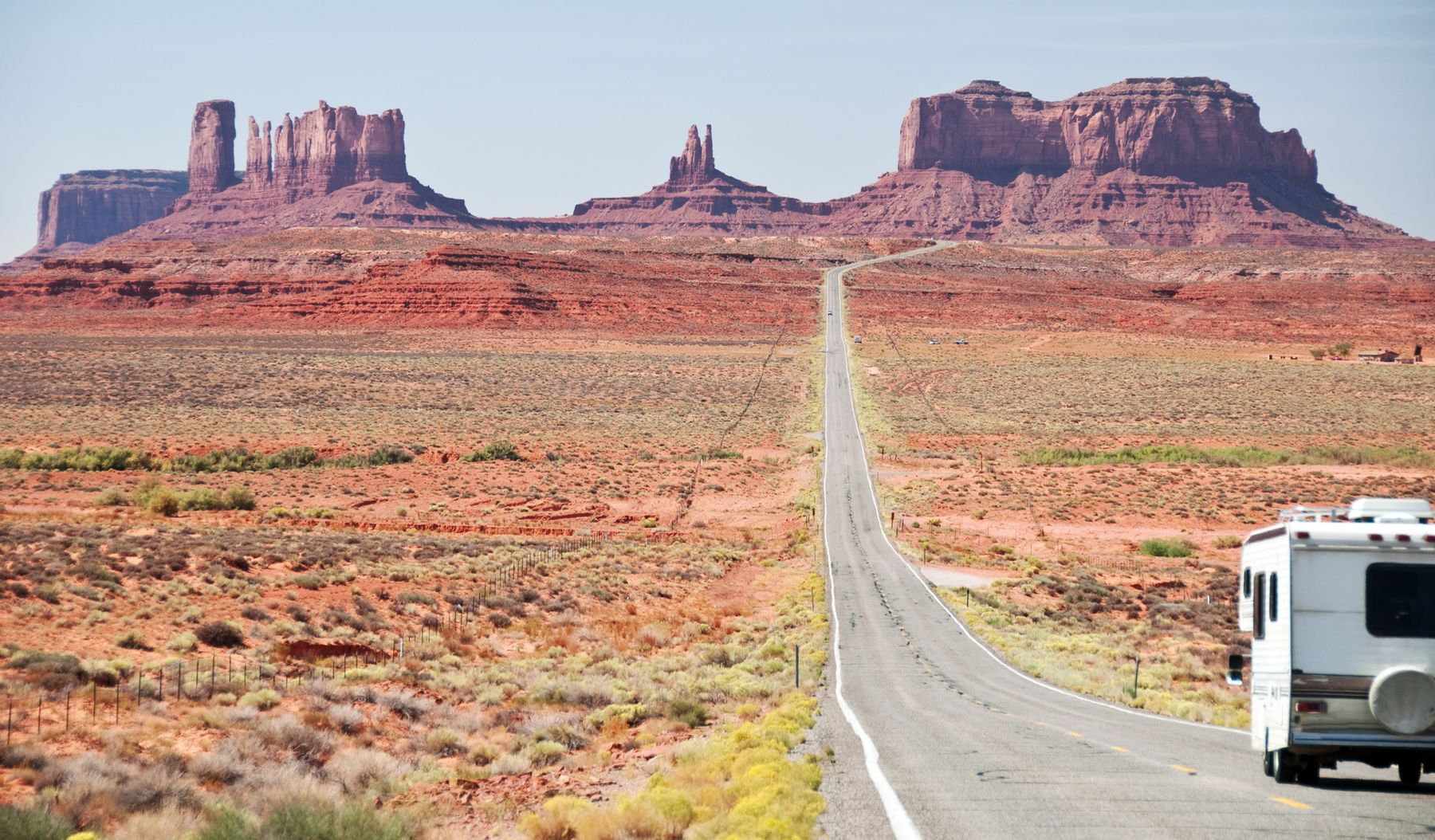 RV traveling down a road in Monument Valley