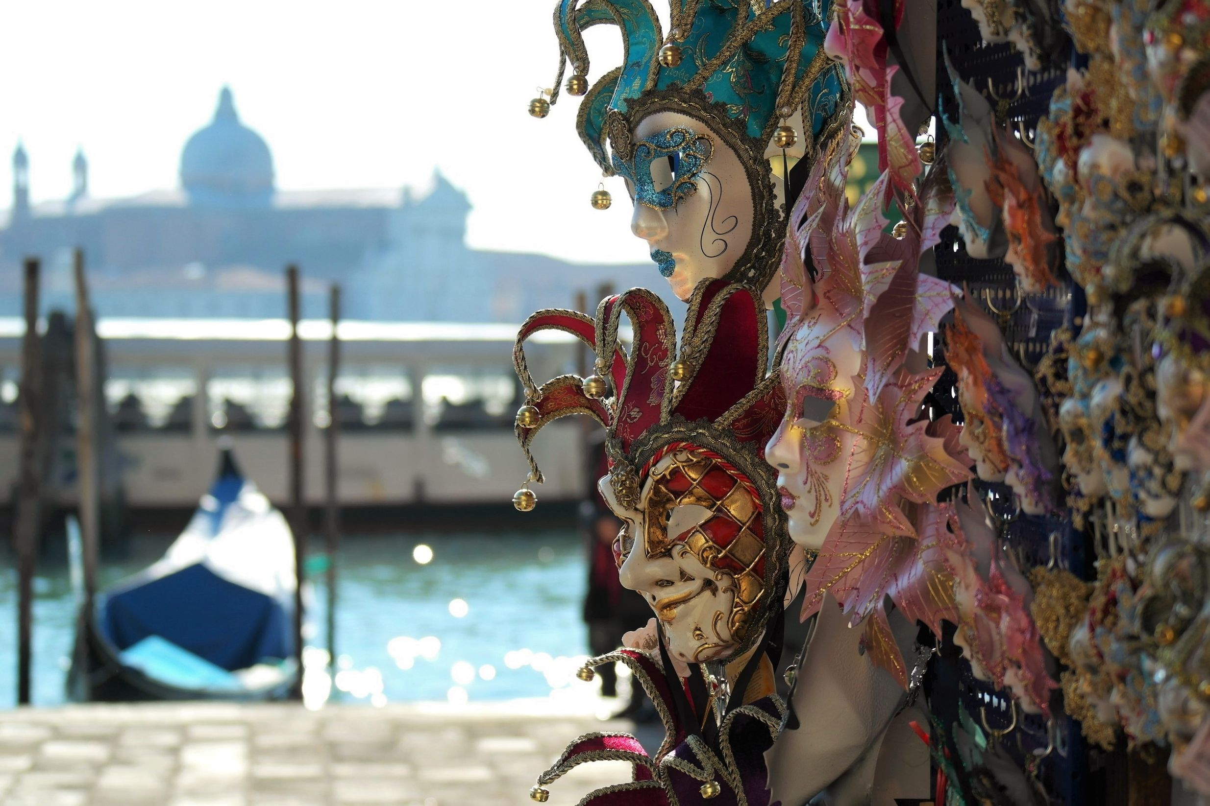 masks displayed near the canal in Venice, Italy during the day