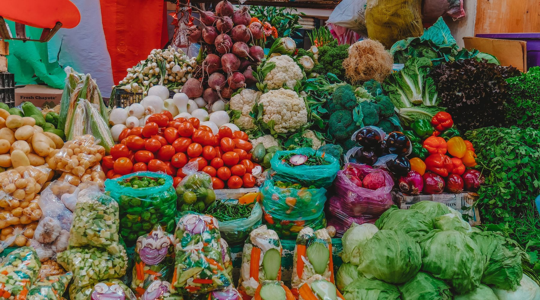 vegetables at the market in Mexico. make markets a part of your daily routine when you travel and work remotely.