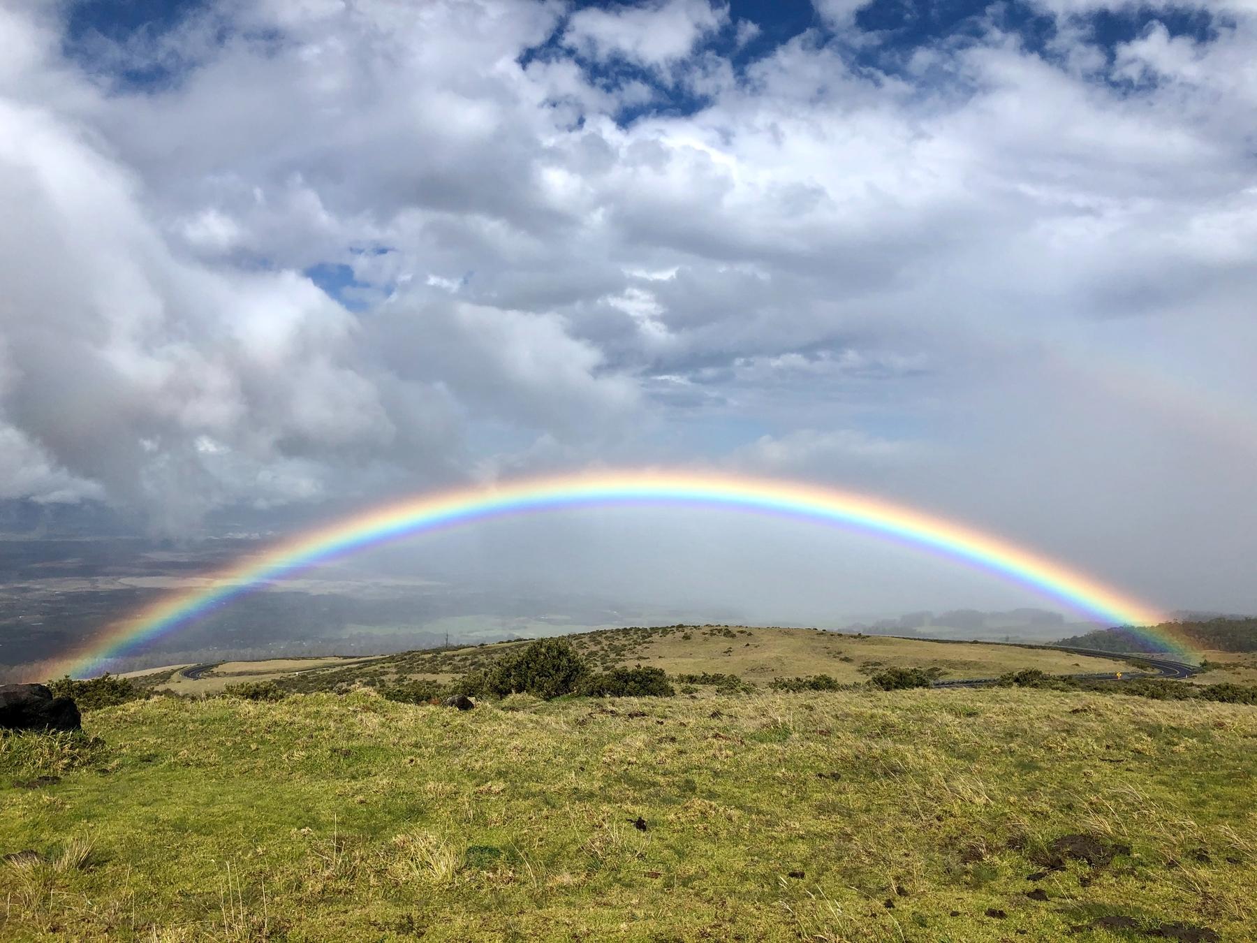 Rainbow on the road leading up to Haleakalā Crater.