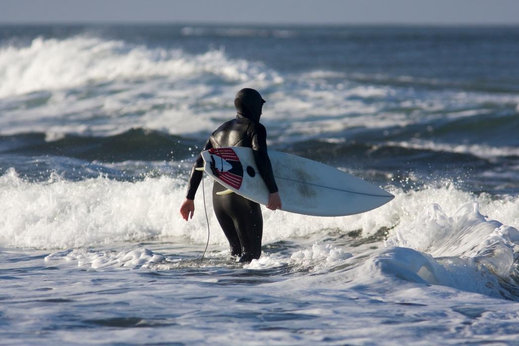 Surfer getting into the water in Bundoran