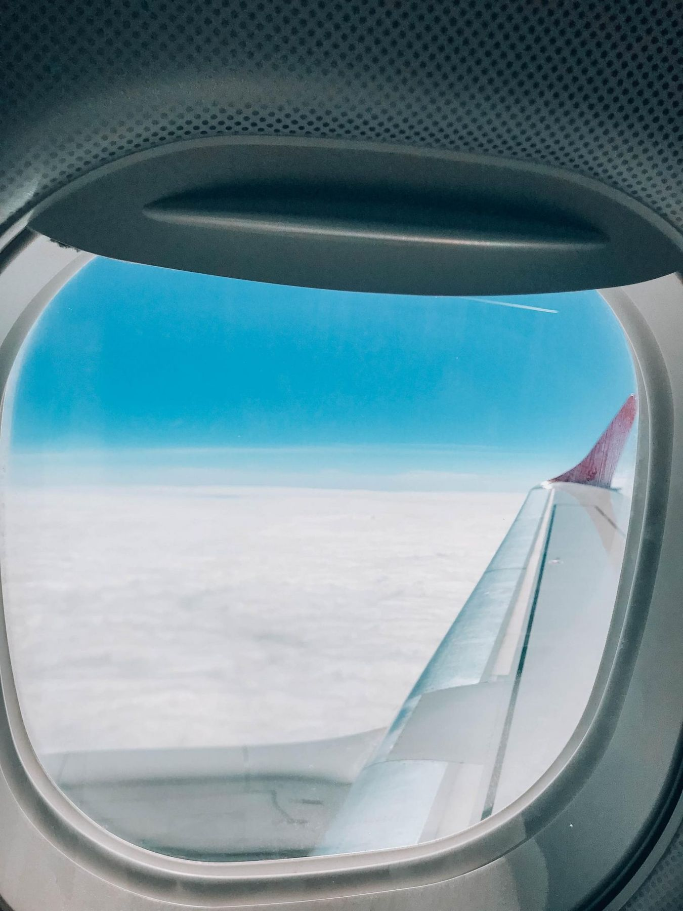 Airplane window, flying during covid-19 coronavirus