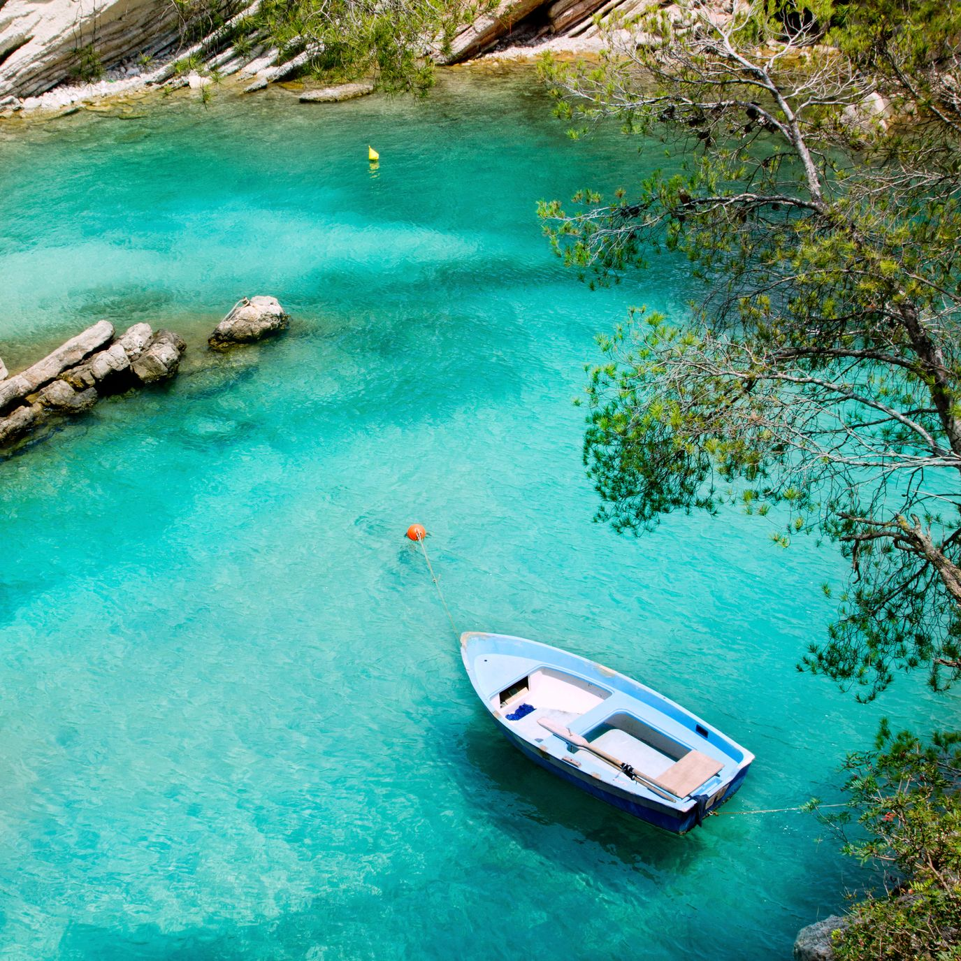 Boat in turquoise waters in Majorca, Spain