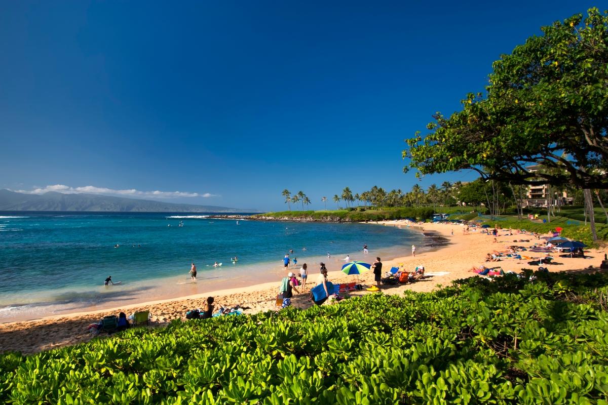 people at the beach on a sunny day in Ka'anapali Beach, Maui, Hawaii