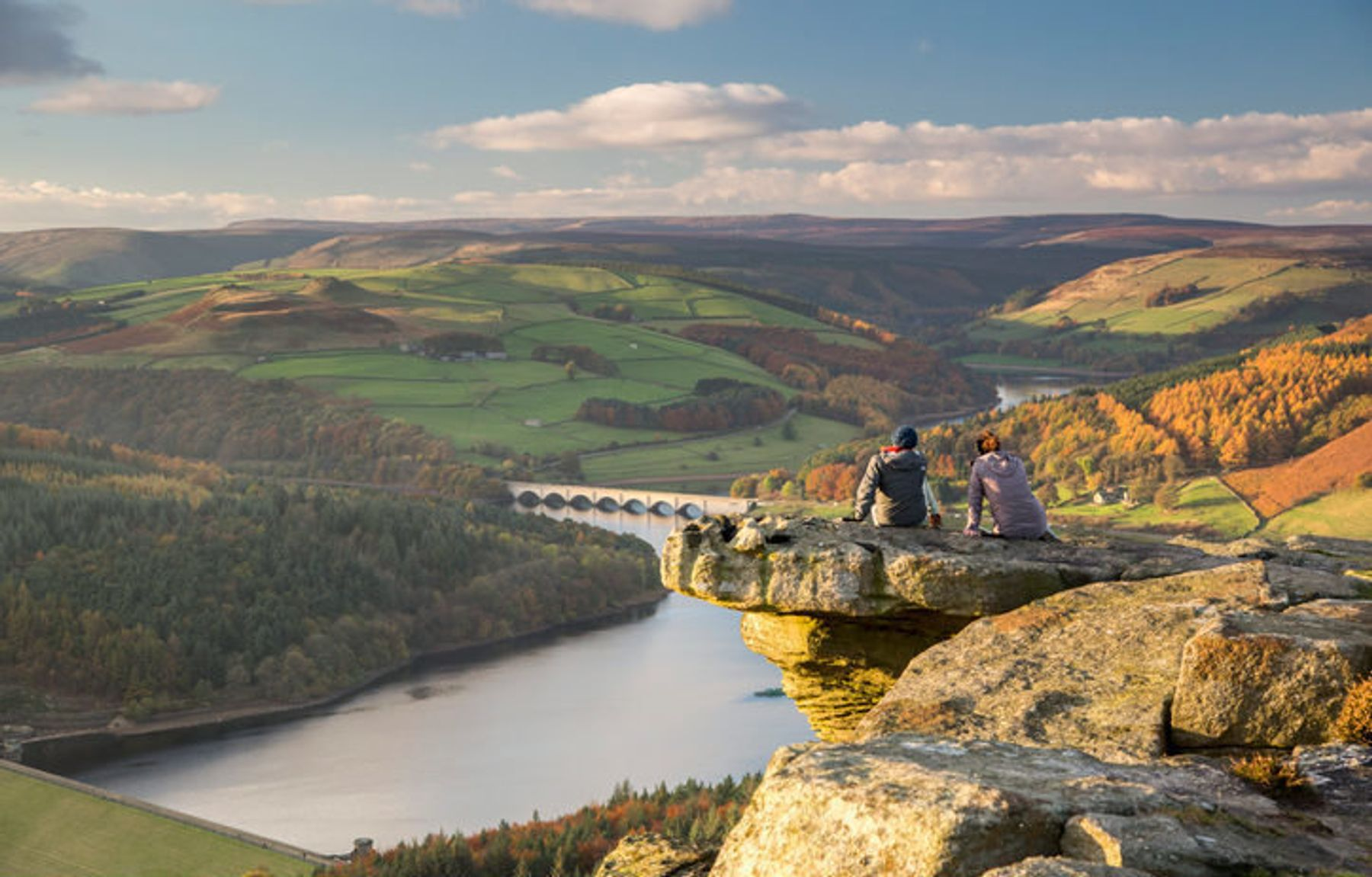 Couple enjoying the views of the Peak District, Derbyshire, England