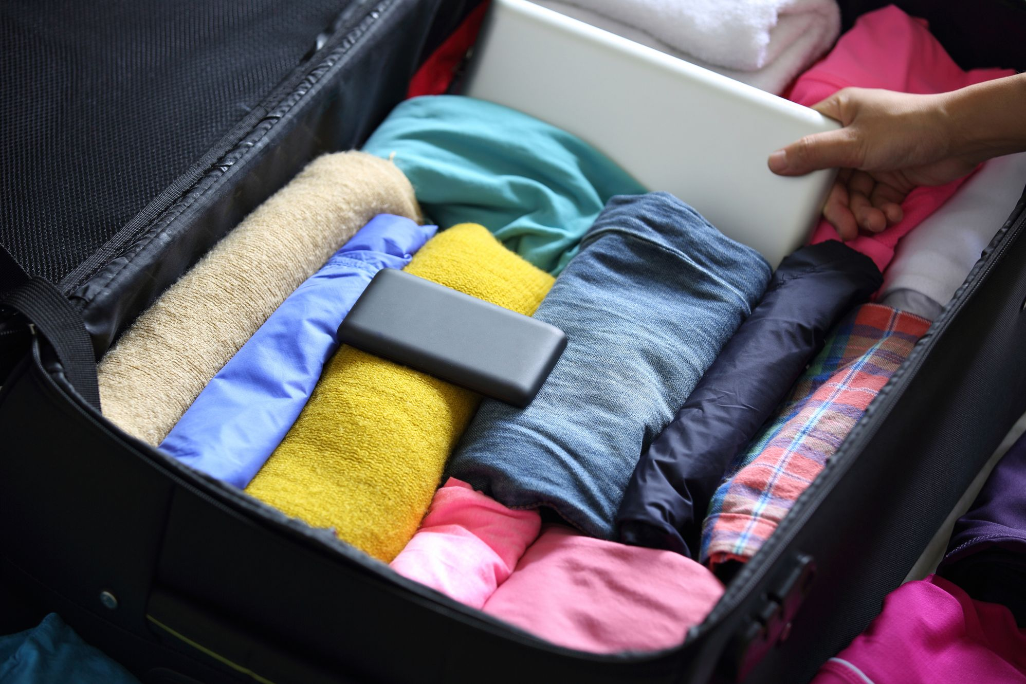 Clothes rolled in a suitcase