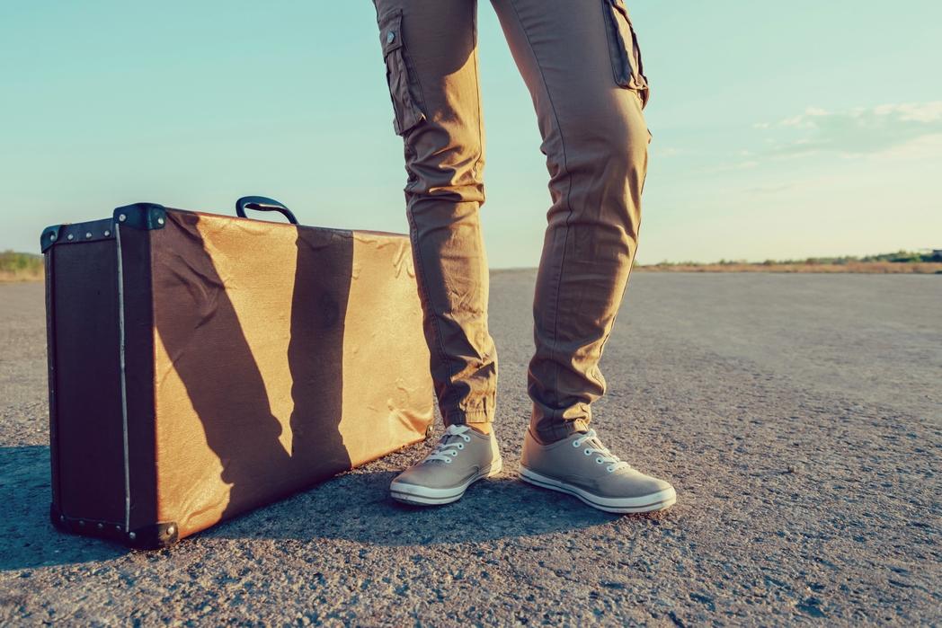 Man travelling with a vintage suitcase - weekend getaways in Ireland