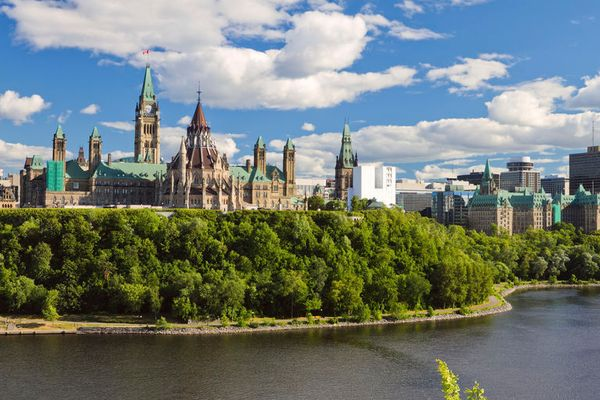 view of the Parliament Buildings by the Ottawa River in Ottawa, Canada