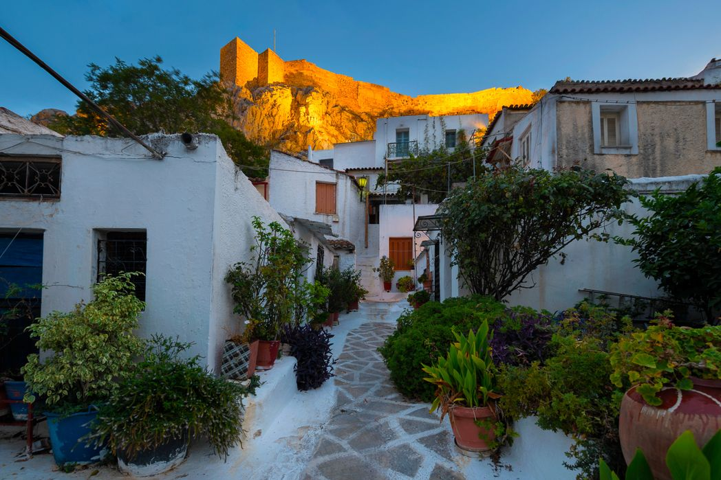 Plaka neighbourhood of Athens, small villas at the bottom of Acropolis hill