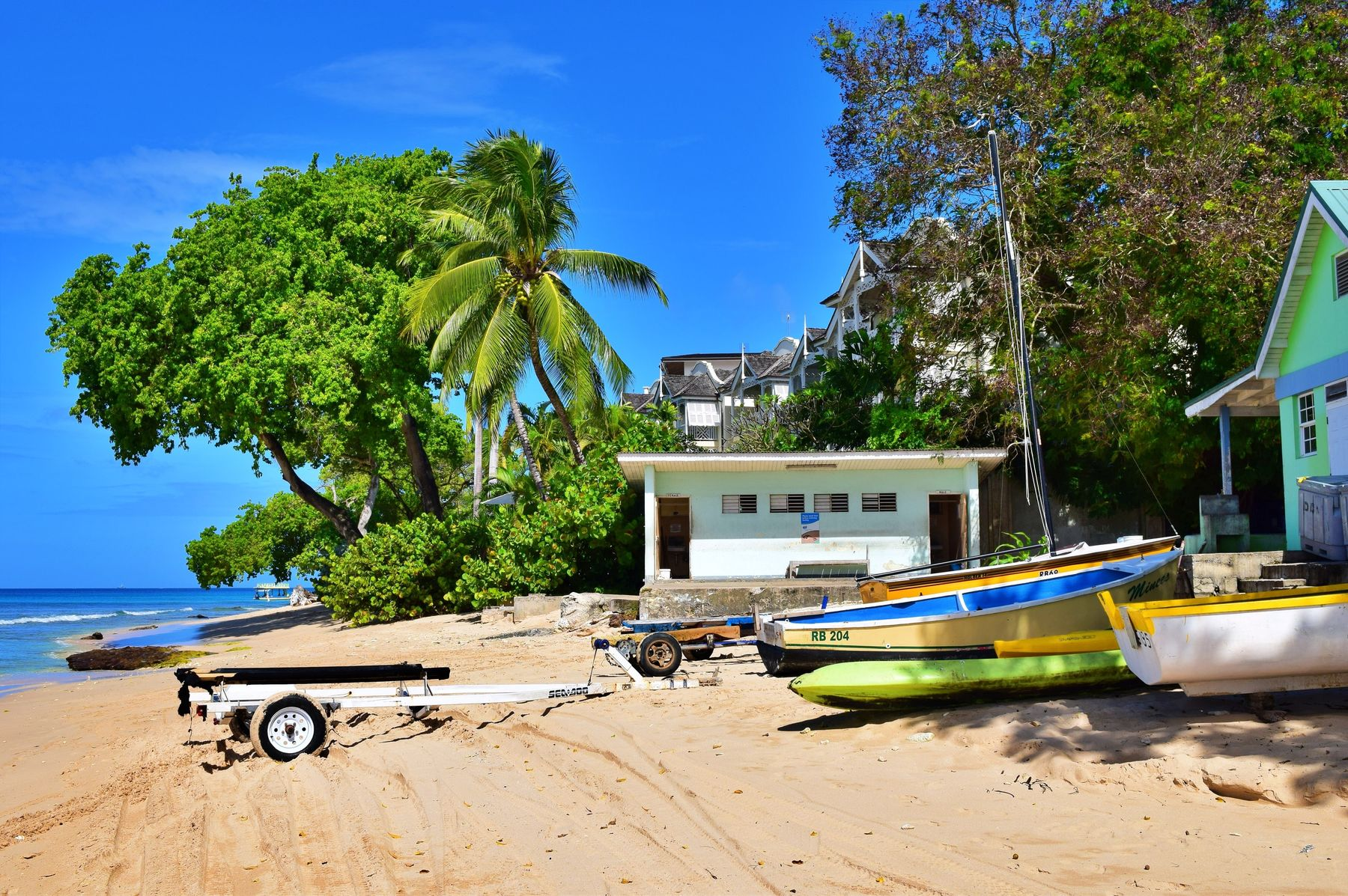 boats by the beach in Barbados, a great Caribbean destination in May
