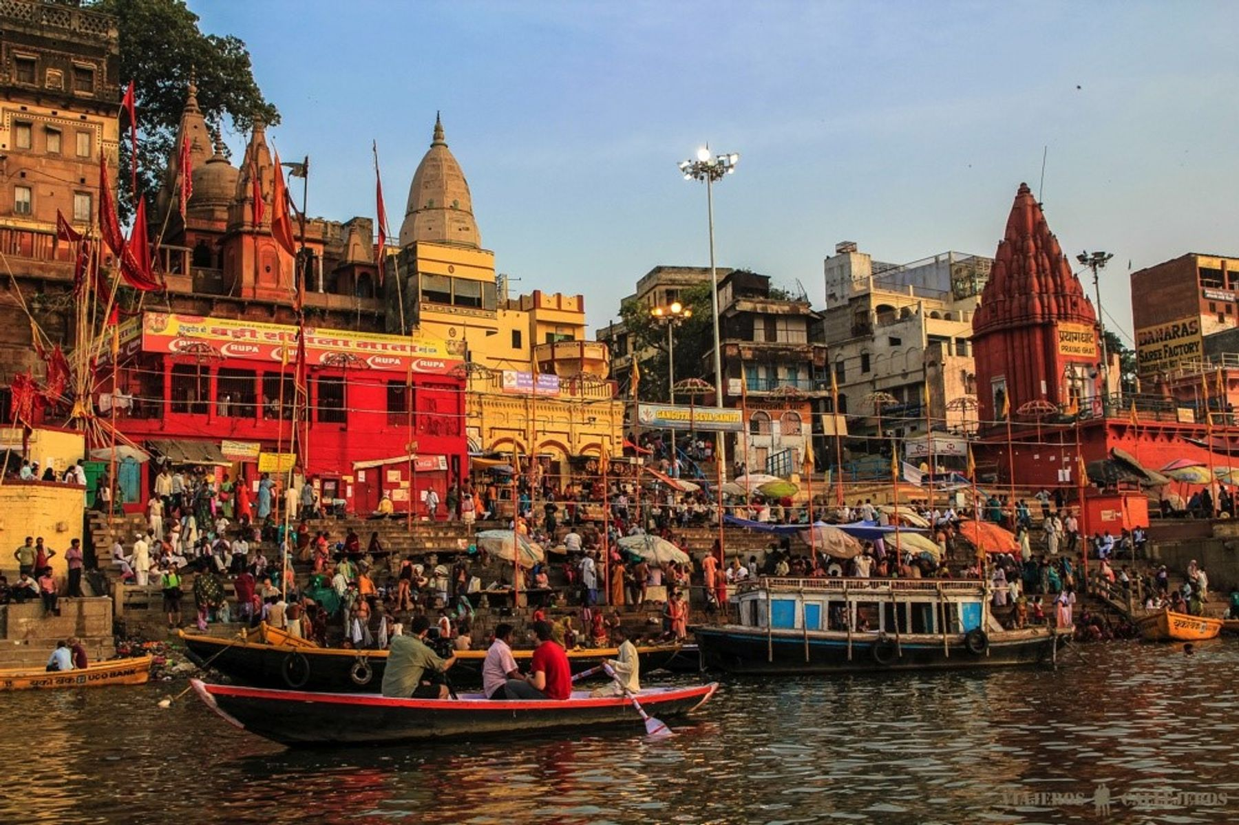 The colorful buildings and boats in India