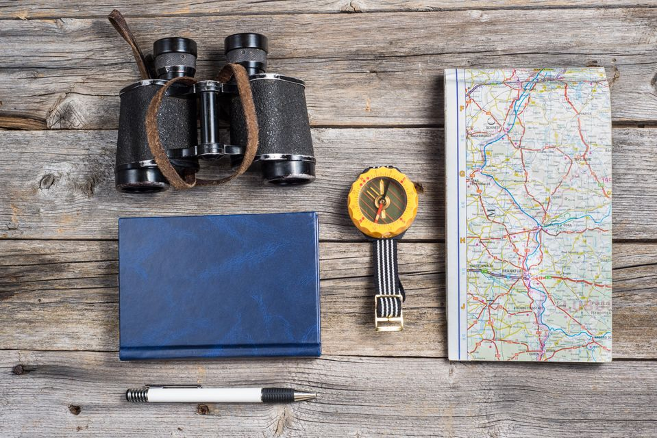 Binoculars, map, notebook and other travel essentials you must have in your hand luggage - one of the best packing tips for your holiday