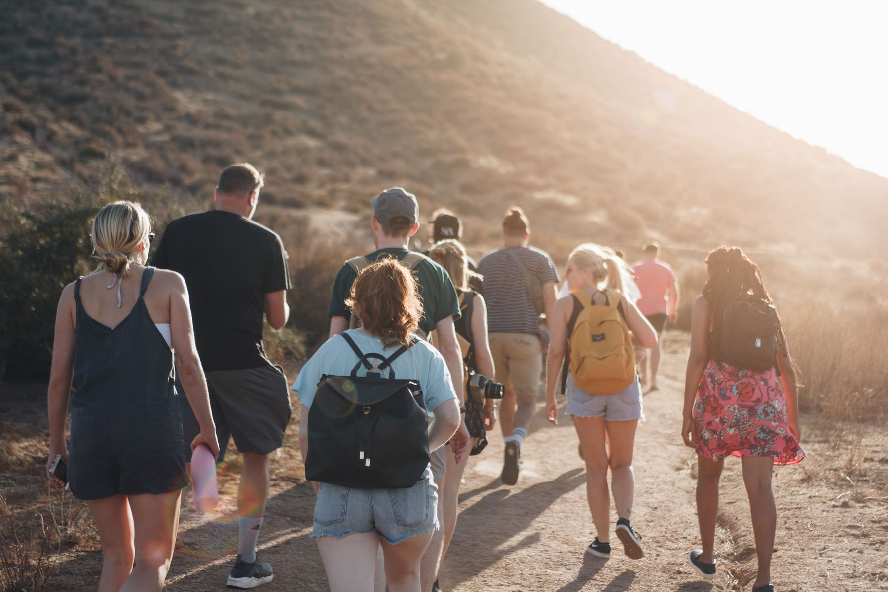 group of travellers walking up a mountain in Temecula, US.