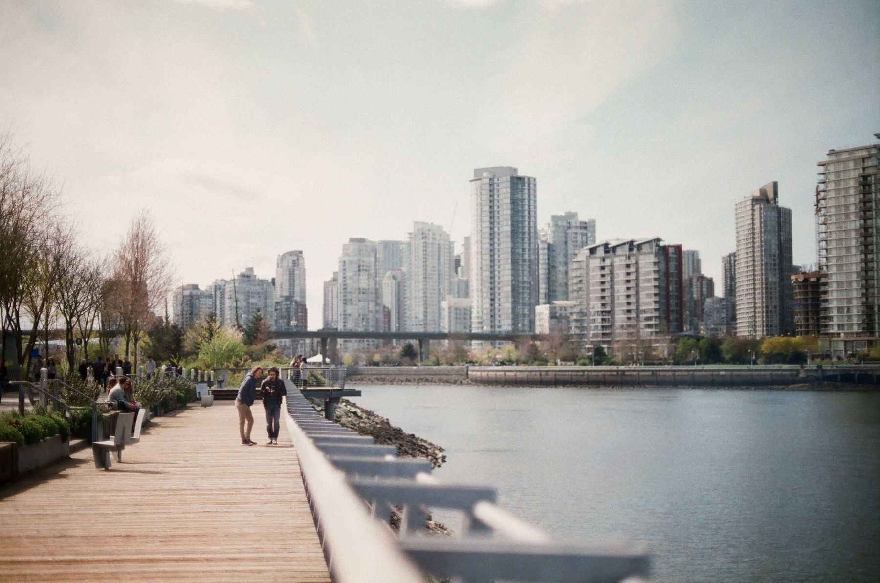 people walking along the seawall in Vancouver, BC