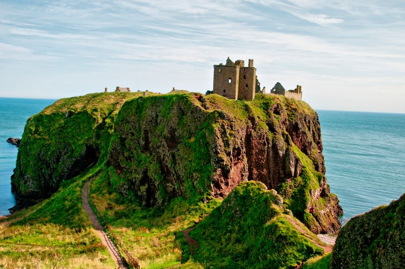 Castle ruins on a hill by the sea