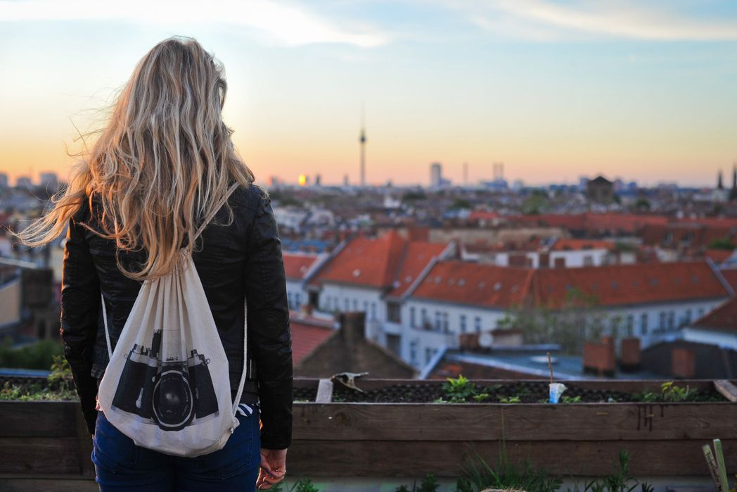 Woman with a backpack checking the view in Berlin