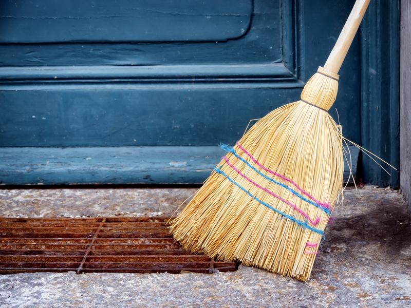 broom next to the door