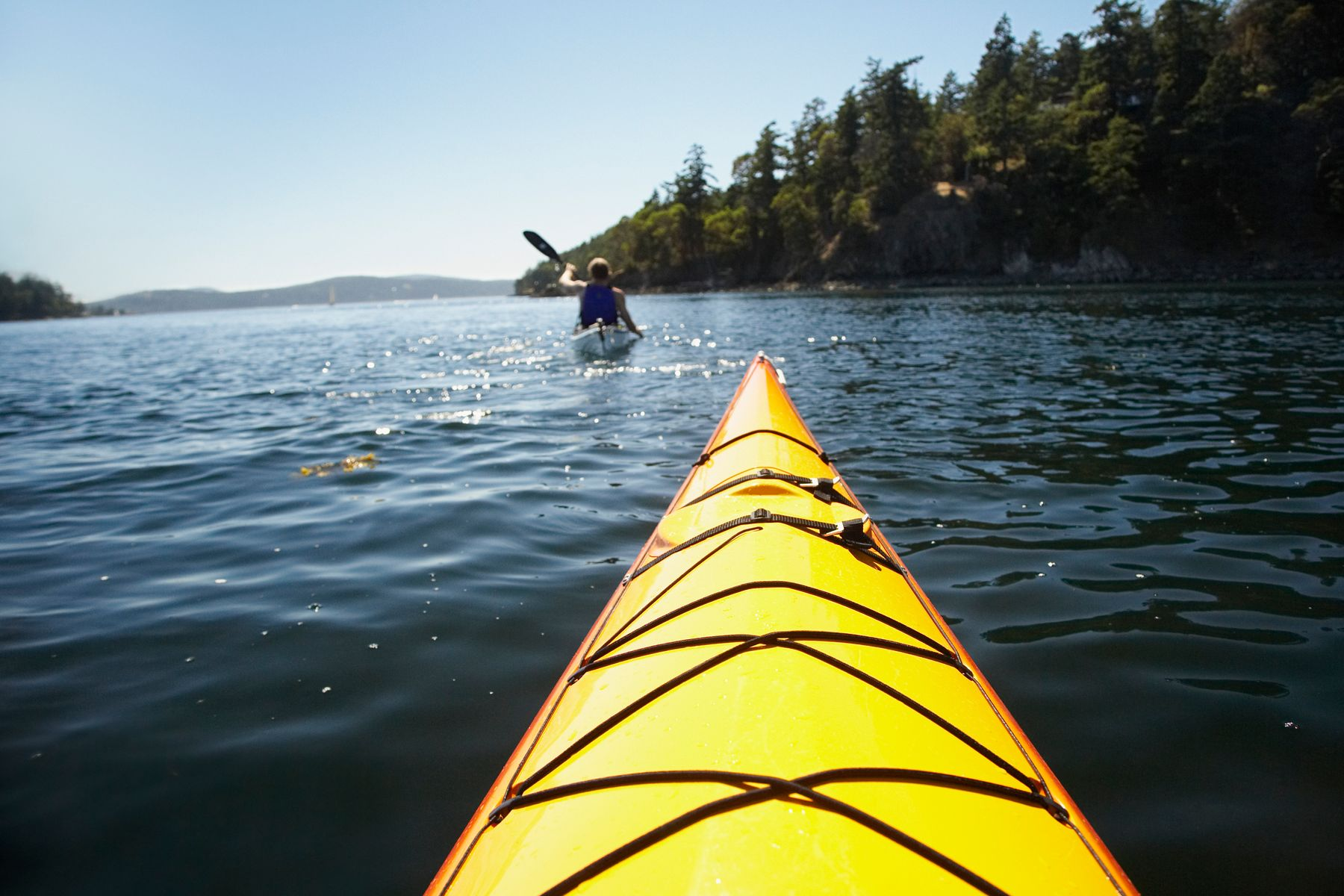 person kayaking in front of another one