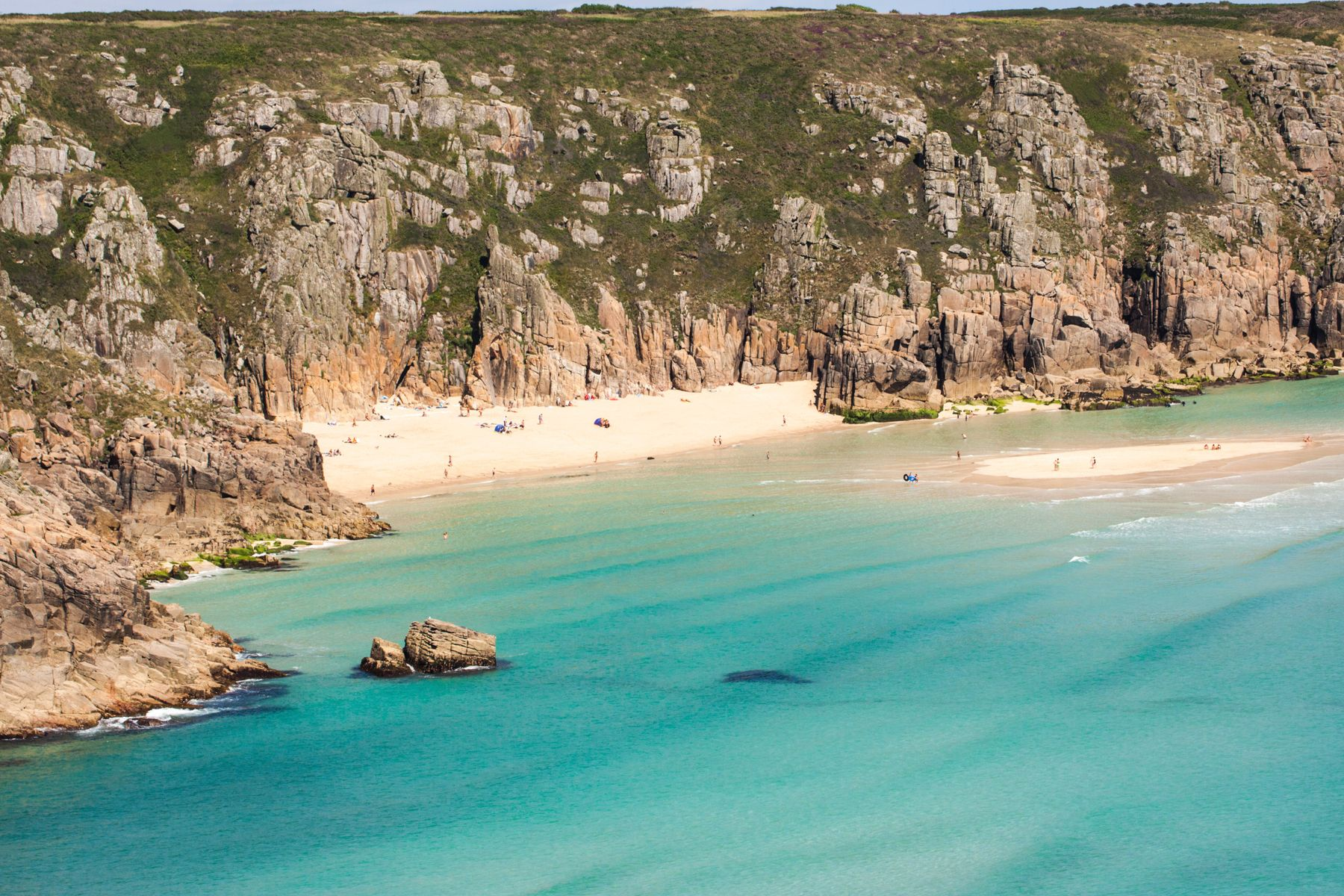 The beautiful white sand at Porthcurno bay, one of Cornwall's most stunning beaches
